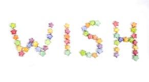 Desiderio della fonte tipografica di origami delle stelle fortunate di colore Fotografia Stock Libera da Diritti
