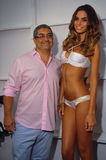 Desigher Augusto Hanimian and model posing backstage at the Luli Fama fashion show during MBFW Swim 2015. MIAMI, FL - JULY 20: Desigher Augusto Hanimian and Royalty Free Stock Image