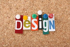 Design. The word Design in cut out magazine letters pinned to a cork notice board Royalty Free Stock Photos