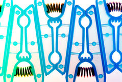 Design abstract background. Closeup detail shot of plastic clothes pegs Stock Images