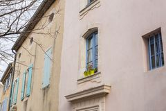 Design, architecture and exterior concept - Blue window with flower pot on the white facade.  stock image