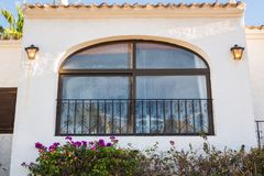 Design, architecture and exterior concept - Large spacious window on the white facade.  royalty free stock image