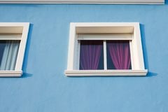 Design, architecture and exterior concept - Small white window on the blue facade.  royalty free stock image