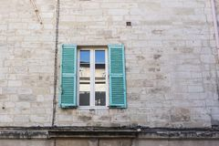 Design, architecture and exterior concept - White and turquoise window on the stone facade.  royalty free stock photos