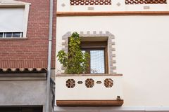 Design, architecture and exterior concept - White wooden window on the white facade.  stock photo
