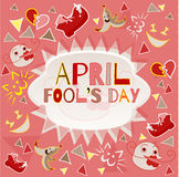 Design banner with april fool`s day logo. Card for congratulations on the Fool`s Day on a light red background with funny objects around the cloud with space Royalty Free Stock Image