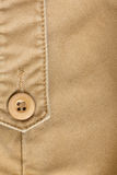 Design botton of brown shirt on fabric textile Stock Images