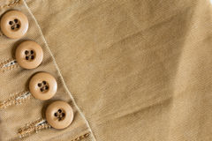 Design botton of brown shirt on fabric textile. Background Stock Image