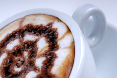 Design on cappuccino. In cup stock photography