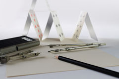 Design of the card house. Still life with elements of architectural design and the card house Royalty Free Stock Photo