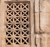 Design of carved window on Indian rock-cut architecture example. 7th century Hindu temple in town Pattadakal, India Stock Images