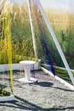 Design chair made of wood and rope. Exterior of the garden and adjacent territory royalty free stock photo