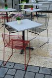 Design chairs cafe. A modern cafe bar with design chairs and flowers Royalty Free Stock Photo