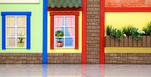 Design of a children`s playroom. Bright colorful fairy-tale motifs. Against the wall. stock photo