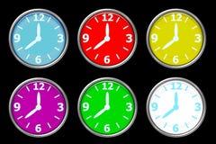 Design clock. Multiple design clock on black paper Royalty Free Stock Image
