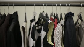 Design collection of winter clothing on hangers. HD shot with slider stock video footage