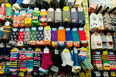 Design colorful socks set in big store with large selection of funny children wear Royalty Free Stock Image