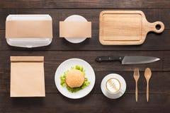 Design concept  brand of mockup burger set on wooden background. Stock Image