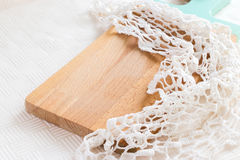 Design concept for creating a collage with food. A wooden cutting board made of light wood and a knitted napkin. Light background. Design concept for creating a royalty free stock photo