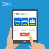 Design concept of hotel booking online. Tablet computer with hand touching a screen. Display with book button and bed. Icons. Mobile application for renting Stock Photos