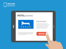 Design concept of hotel booking online. Tablet computer with hand touching a screen. Display with book button and bed. Icons. Mobile application for renting Stock Photography