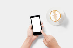Design concept of mockup using smartphone and coffee set isolate Stock Photography