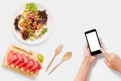 Design concept of mockup Using smartphone with salad, watermelon set. Royalty Free Stock Photo