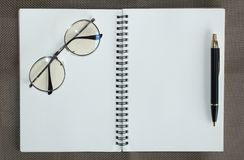 Top view of hardcover kraft notebook and ballpoint pen royalty free stock photo