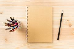 Top view of kraft spiral notebook isolated on background for mockup stock photo
