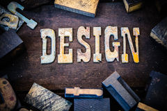 Design Concept Wood and Rusted Metal Letters. The word DESIGN written in rusted metal letters surrounded by vintage wooden and metal letterpress type Stock Photos