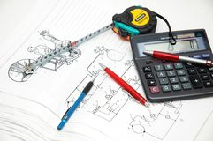 Design drawings. Calculator, pens and measuring tape Royalty Free Stock Images