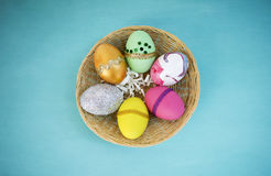 Design Easter egg collections in round rattan basket Royalty Free Stock Image