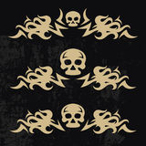 Design elements with flame. Design elements with fire flame and skull on a grunge background Stock Photo