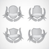 Design elements. Vector set of shields with Laurel. Wreaths and ribbons. Style of engraving. EPS 10 Royalty Free Stock Image