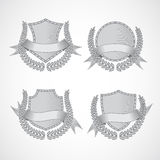 Design elements. Vector set of shields with Laurel. Wreaths and ribbons. Style of engraving. EPS 10 Stock Images
