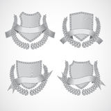 Design elements. Vector set of shields with Laurel. Wreaths and ribbons. Style of engraving. EPS 10 Royalty Free Stock Images