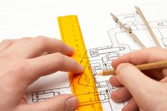 Design engineer. Draws a reducer assembly drawing Stock Image