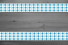 Background design for the famous, traditional bavarian Oktoberfest. Design for the famous, traditional bavarian Oktoberfest. Oktoberfest design over wooden stock image