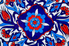 Design with flowers on ceramic pot in a style of Turkish historical tiles.  Patterned texture of Middle East. Stock Image