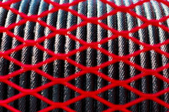 Design foreground blur red net and rope sling crane background. Royalty Free Stock Image