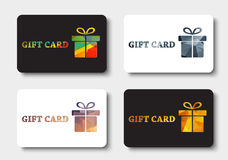 Design gift cards with abstract polygonal boxes. Design white and black gift cards. Templates with a box and ribbon with gold, bronze, silver and colored Stock Photos