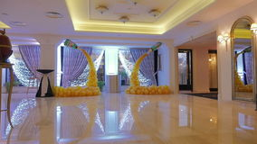 The design of a hall in the yellow balloons. Bunch of colored balloon decoration. Yellow background.