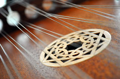 Design on a Hammered Dulcimer. Blurred strings over a Celtic design on a hammered dulcimer royalty free stock images