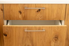 Design of kitchen cabinets from solid wood. stock image