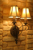Design - Lamp. Lamp on bricks lighting up a room royalty free stock image