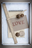 Design love. Love card and tool in zinc tray Royalty Free Stock Image