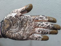 Mehndi, A design hands with henna. A design made on hand with Henna, A temporary henna tattto, reddish browndye royalty free stock images