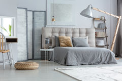 Design modern bedroom. Material pouf on floor and lamp in design modern bedroom stock image