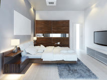 The design of modern light bedroom with a large sliding closet. Royalty Free Stock Photo