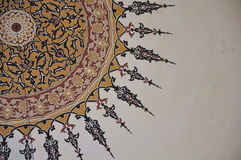 Design in mosque. Abstract view of a circular design against the white wall of a mosque Royalty Free Stock Photo